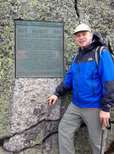 On top of Mt. Marcy, highest peak in NYS, in front of plaque dedicated to Geologist James Hutton