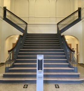 Mayborn's grand staircase, with hand sanitizer station.