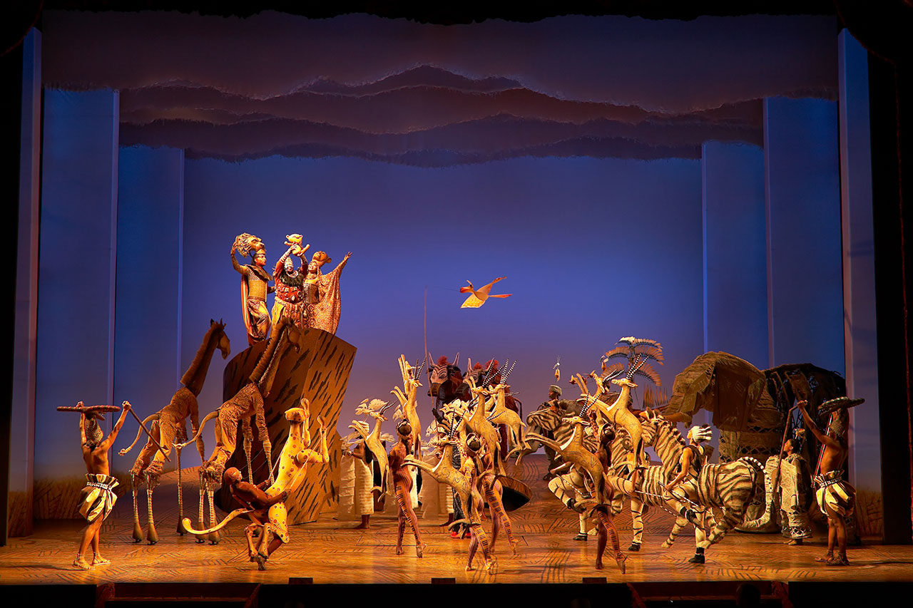 Circle of Life, showcasing the set for Pride Rock and the animal puppets. Photo by Joan Marcus.