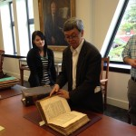 Professor C.L. Seow and student Serena Jarvis look through one of the oldest Hebrew grammars made for English students. The grammar also included a Hebrew to English dictionary.