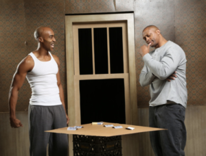 """Joel Diggs (Booth) and Eddie George (Lincoln) perform in """"Topdog/Underdog"""" on February 15th, 2019."""